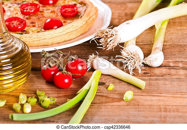 Leek and tomato quiche. - csp42336646