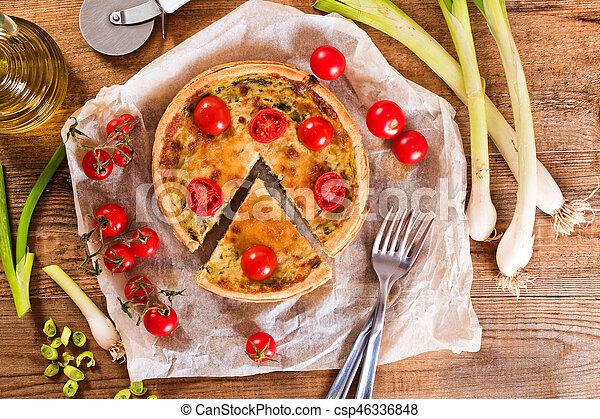 Leek and tomato quiche. - csp46336848