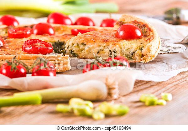 Leek and tomato quiche. - csp45193494