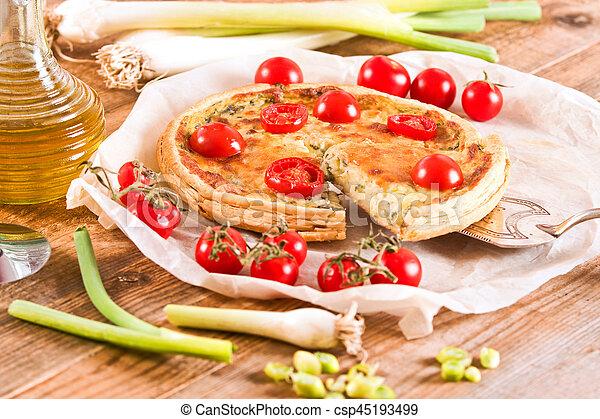 Leek and tomato quiche. - csp45193499