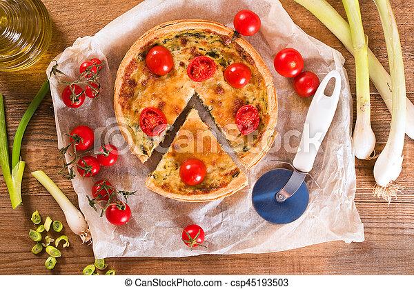 Leek and tomato quiche. - csp45193503
