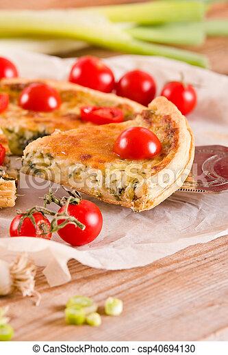 Leek and tomato quiche. - csp40694130