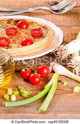 Leek and tomato quiche. - csp45195338