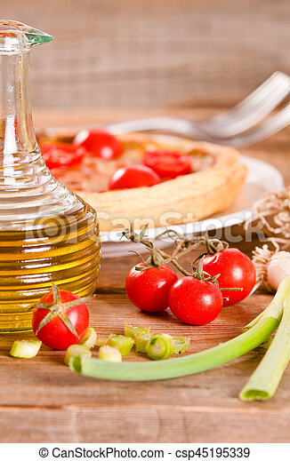 Leek and tomato quiche. - csp45195339