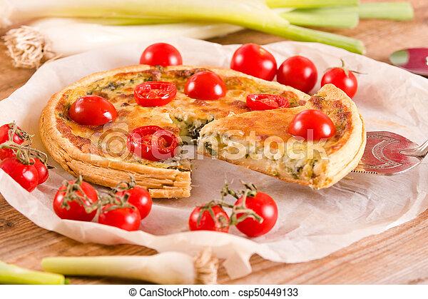 Leek and tomato quiche. - csp50449133