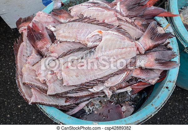 leftover fish parts - csp42889382