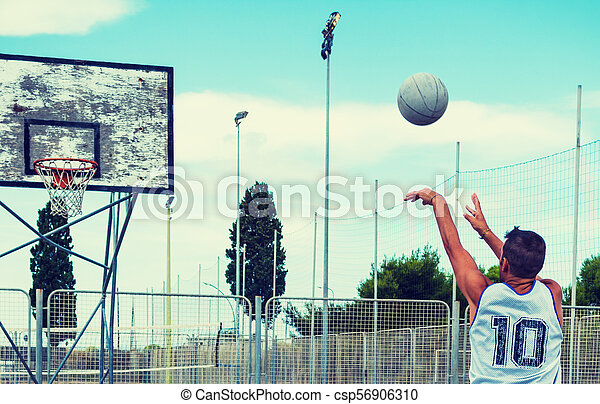 Lefty basketball player shooting in a playground - csp56906310