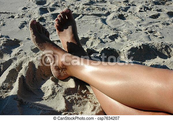 Legs on the beach - csp7634207
