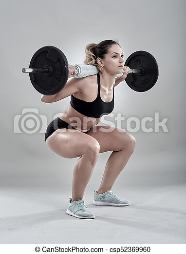 legs workout with barbell young woman doing squats with