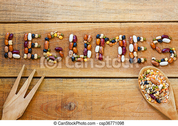 Legumes word with wood background - csp36771098