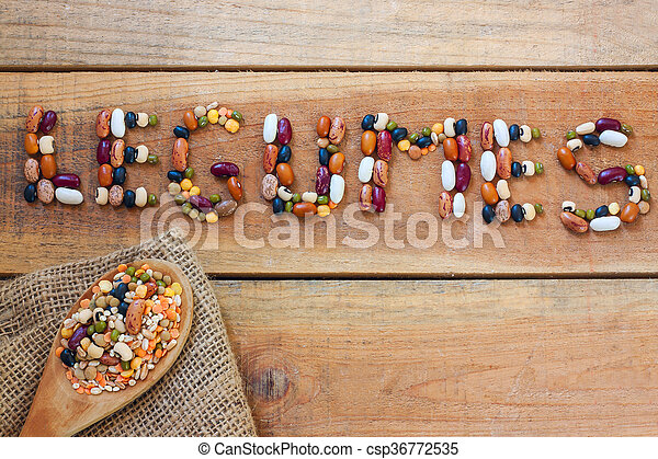 Legumes word with wood background - csp36772535