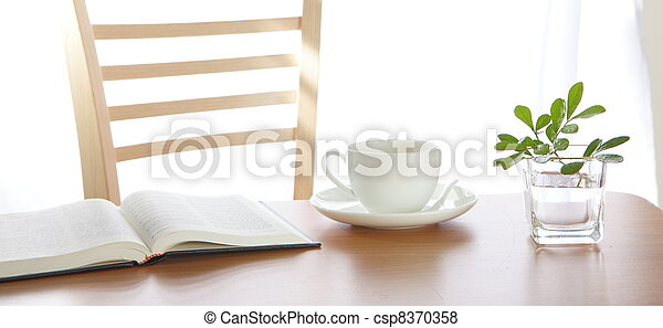Leisure time with a book and coffee - csp8370358