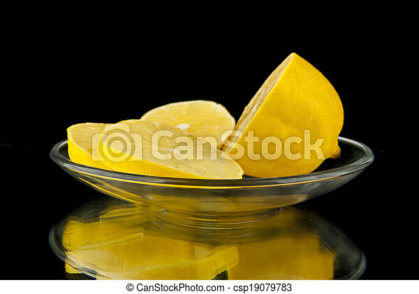 lemon is cut in a glass saucer - csp19079783