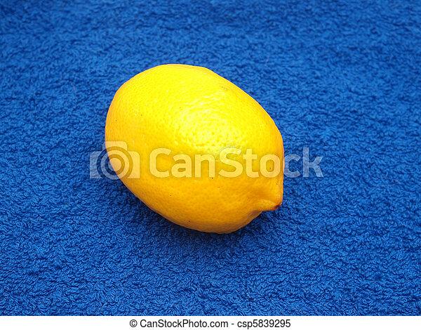 Lemon on a dark blue fabric - csp5839295