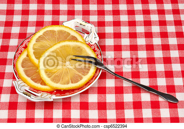 lemon on a plate with a fork - csp6522394