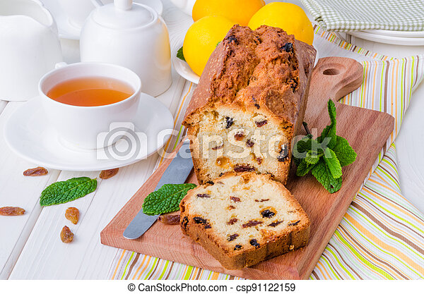 Lemon pound cake with dried cranberries and raisins on white wooden background - csp91122159