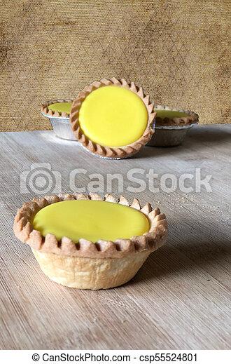 lemon tarts on wooden table - csp55524801