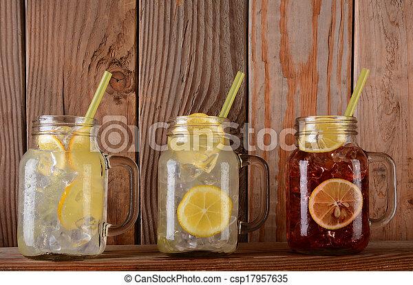 Lemonade and Fruit Juice Glasses on Shelf - csp17957635