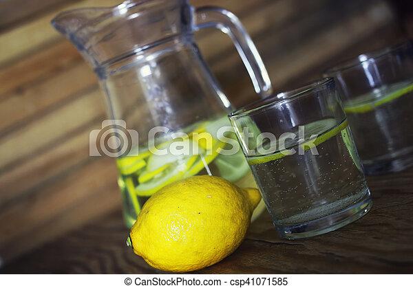 Lemonade in carafe lemon - csp41071585