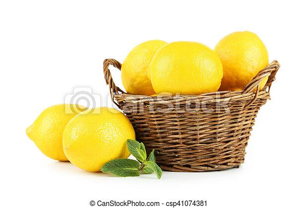 Lemons in basket isolated on white - csp41074381