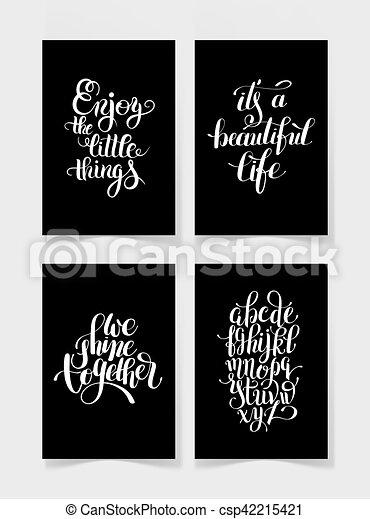 Un conjunto de cuatro letras blancas y negras escritas a mano - csp42215421