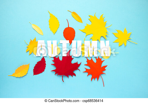 letter autumn cut from paper with paper autumn leaves - csp68536414