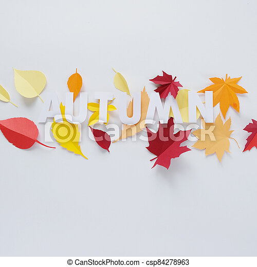 letter autumn cut from paper with paper autumn leaves - csp84278963