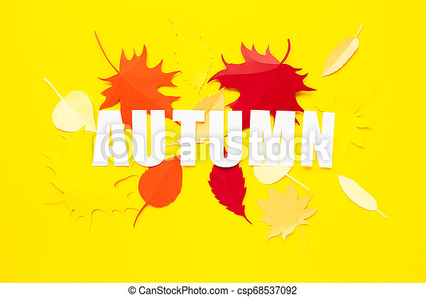 letter autumn cut from paper with paper autumn leaves - csp68537092