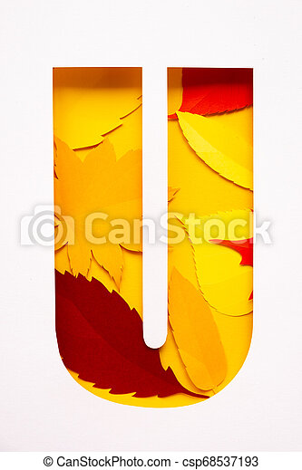 letter u cut from paper with paper autumn leaves - csp68537193