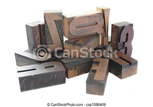 letterpress wood type arrangement - csp1586409
