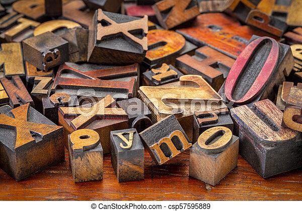letterpress wood type blocks background - csp57595889
