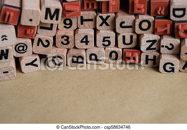 letters and numbers on wooden blocks / cubes - letterpress , - csp58634746