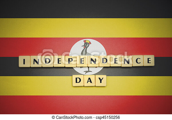 letters with text independence day on the national flag of uganda. - csp45150256