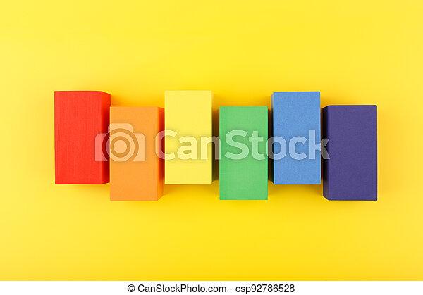 LGBT flag made of rectangular geometric figures on yellow background. - csp92786528