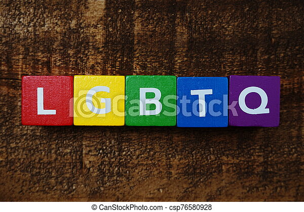 LGBTQ alphabet letters with space copy on wooden background - csp76580928