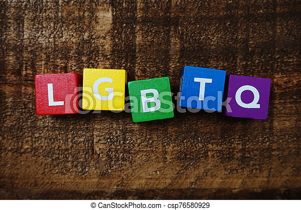 LGBTQ alphabet letters with space copy on wooden background - csp76580929