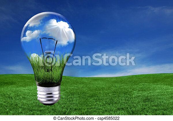 Grüne Energielösungen mit einer Glühbirne in die Landschaft verwandelt - csp4585022