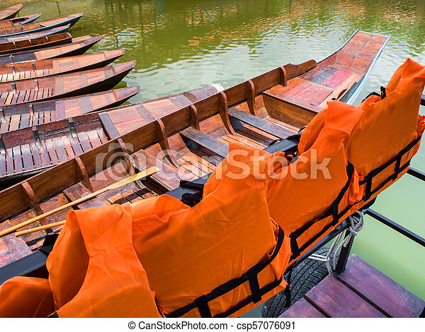 Life jacket for passengers of boat trip in the lake - csp57076091