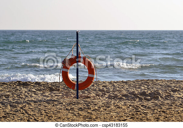 Lifebuoy on the bank of the Black Sea. - csp43183155