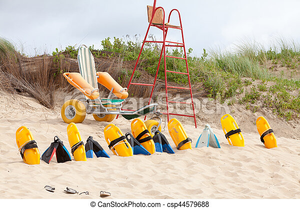Lifesaver chair and equipment on the beach - csp44579688