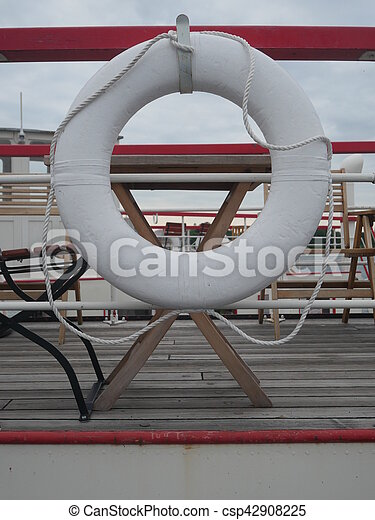 lifesaver ship lifebuoy and hanging on a boat