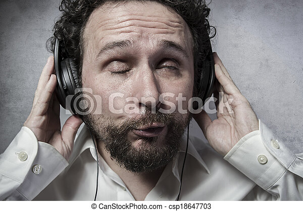 Lifestyle Listening And Enjoying Music With Headphones Man In White Shirt With Funny Expressions