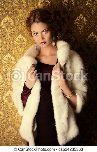 f4f59bdfb Lifestyle luxury. Elegant young woman in evening dress and mink fur ...