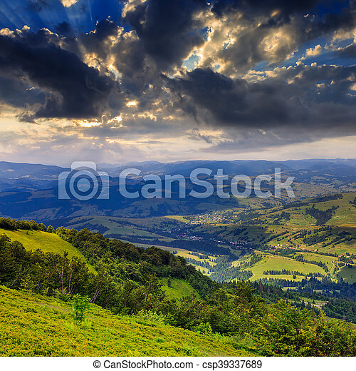light  beam falls on hillside with autumn forest in mountain - csp39337689