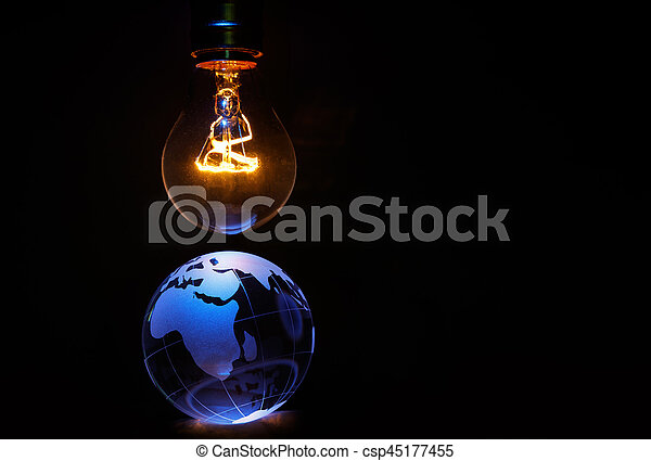 Light bulb and earth, concept of global issues, Europe, Africa
