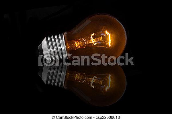 Light bulb on black background - csp22508618