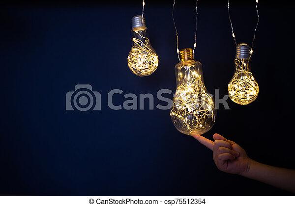 Light Bulbs On Dark Background Three Light Bulbs With Small Highlights Sparkles On A Dark Uniform Background Children S
