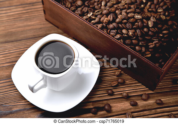 light coffee beans wooden box with coffee, natural wooden background - csp71765019