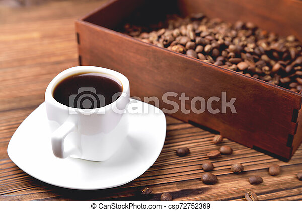 light coffee beans wooden box with coffee, natural wooden background - csp72752369
