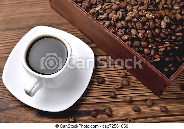 light coffee beans wooden box with coffee, natural wooden background - csp72561050